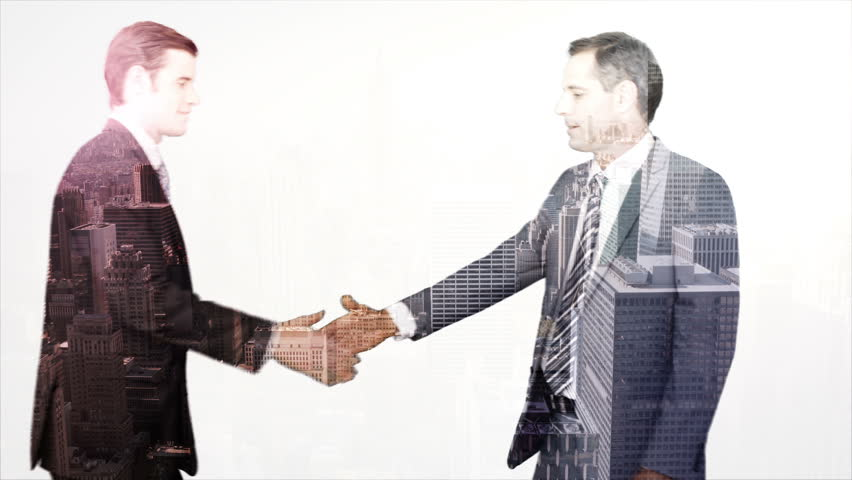 Digitally generated of business workers shaking hand with skyscraper overlay - HD stock video clip