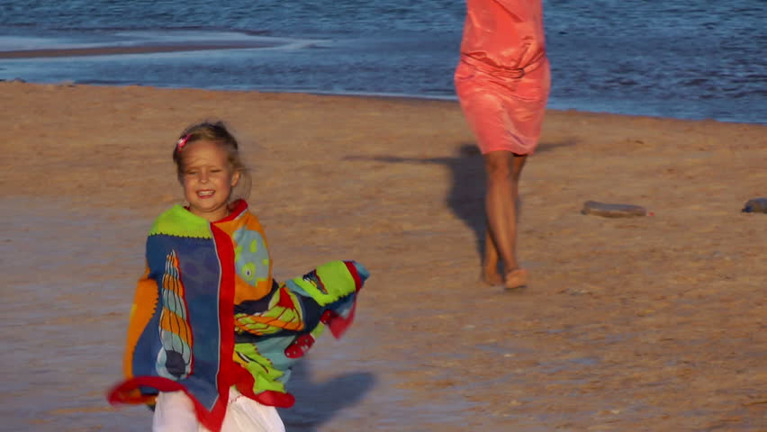 girl and her mother play on the beach - HD stock video clip