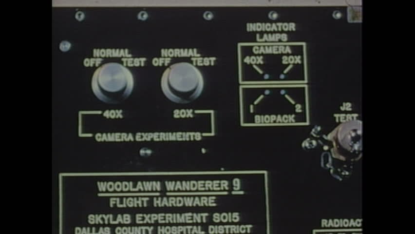 UNITED STATES 1970s: Close up of labels on control panel / Magnified view of microscopic cells.