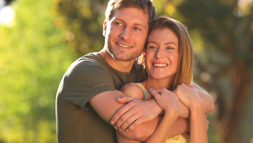 Couple in love cuddling in a park | Shutterstock HD Video #1135870