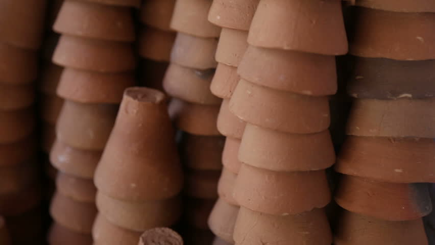 Ceramic cups standing on a pile one on another.