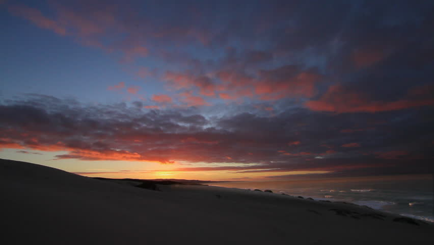 Spectacular sunrise Over the Dunes and Ocean Timelapse at De Hoop Nature Reserve