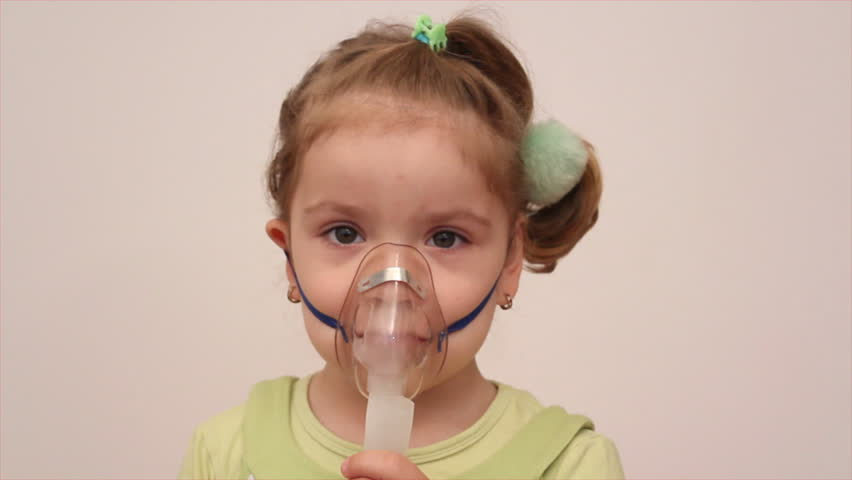 child with inhalation mask - HD stock footage clip