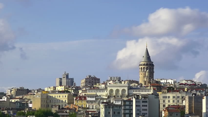Galata Tower with beatiful spring clouds moving time lapse. Istanbul, Turkey Country