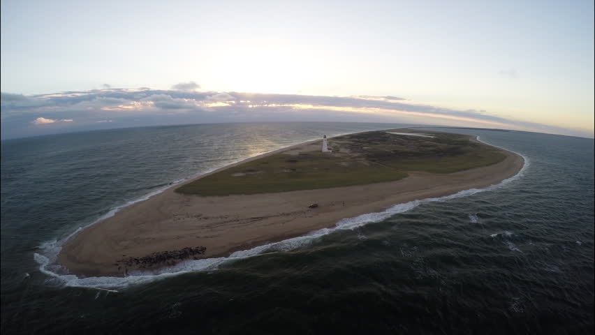 Sunset seascape aerial with seals. Aerial flyover. Sunset seascape in Nantucket, Massachusetts with seals. 1080p HD. - HD stock footage clip