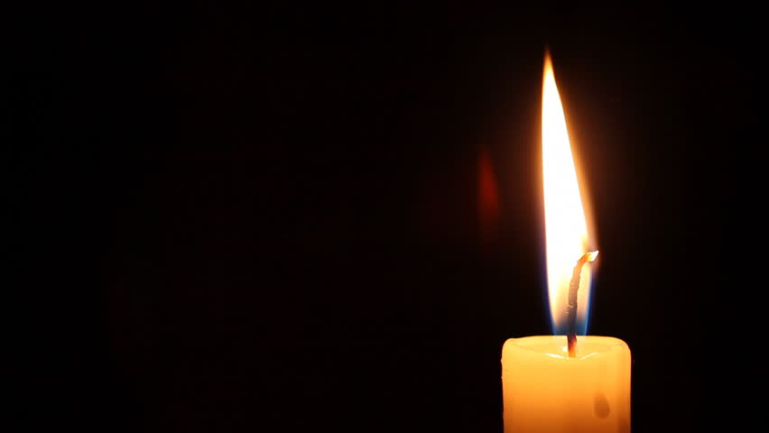 Burning candle dies out - isolated on black background HD video 1920x1080