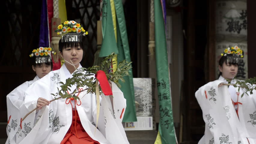 TOKYO - APRIL 03: Traditional religious dance at a shrine on April 03, 2011 in Kawasaki, Tokyo.  Most Japanese are Buddhist, Shintoist or both; About 91 million people in Japan claim to be Buddhist - HD stock footage clip