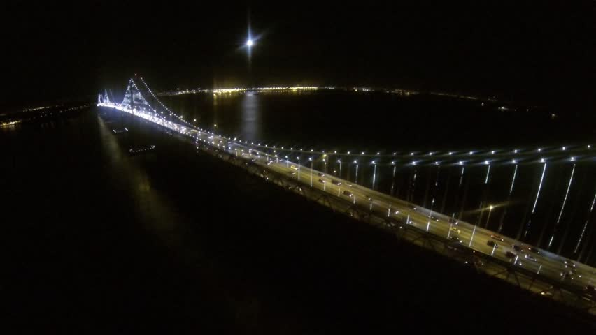 SF Night Lights of the city and bay bridge by Epic Flight Films.