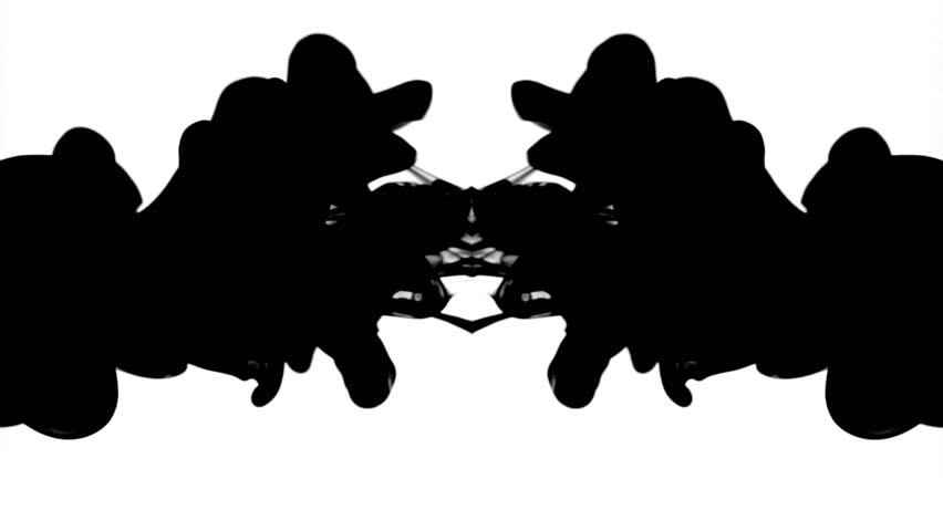 Black ink in water, reflected like a Rorschach inkblot test, moving gracefully