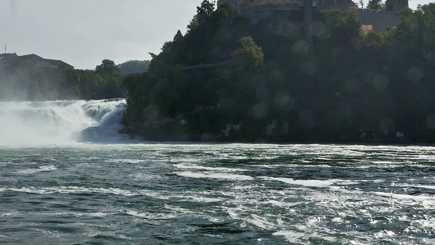 RHINE FALLS, SWITZERLAND - SEPT 2014: Tourist excursion boats ply the waters below the famous Rhine Falls in Switzerland taking tourist into the mists below the falls. - HD stock footage clip