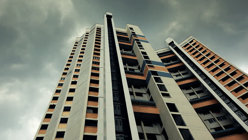 Colorful building exterior with outside elevator moving up, clouds time lapsed softly, extreme seen in Singapore  - HD stock video clip