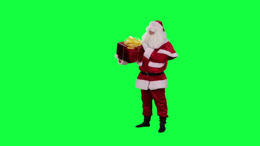 Santa Claus with a gift box chroma key (green screen). Santa examines present isolated on green