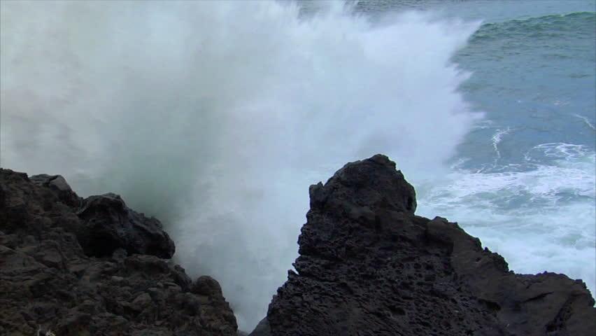 big wave crushing lava coast slow motion - HD stock video clip