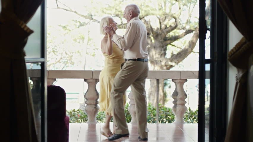 Old people and dance, elderly man and woman as dancers, senior caucasian couple on vacation, dancing on terrace in hotel during holidays - HD stock video clip