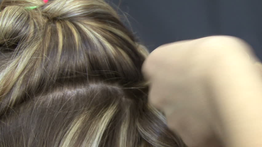 Hair wave. Barber makes a hairstyle for girls. - HD stock footage clip