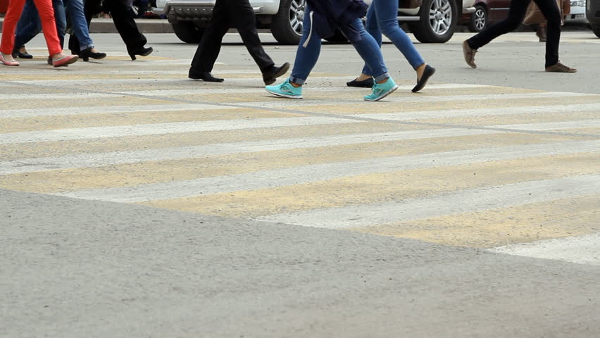 Volgograd, Russsian Federation - 09 May, 2015: People cross the road at a pedestrian crossing.