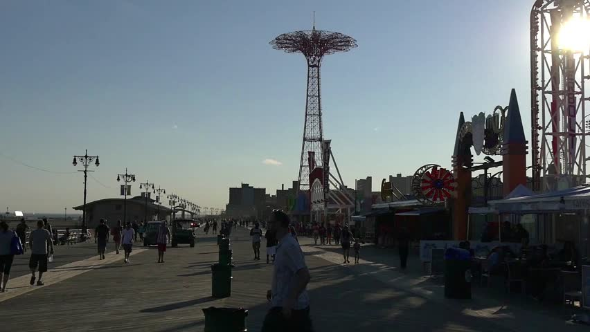 NEW YORK - CIRCA JULY, 2015: people walking on Coney island boardwalk circa July 2015 in Brooklyn, New York. - HD stock video clip