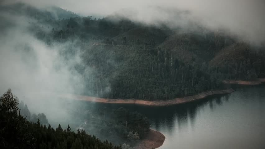 Cinemagraph Loop - View of a lake covered in fog during morning sunrise. Motion photo - HD stock footage clip