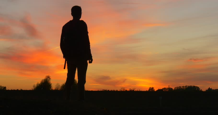 Man With Backpack ,Man's Silhouette at The Sunset ,Man is Standing, Turns ,Walking Away, Couple is Walking on a Horizon, Bright Yellow Sky, Trees Silhouettes, sunset, yellow sky, bright sky, colorful