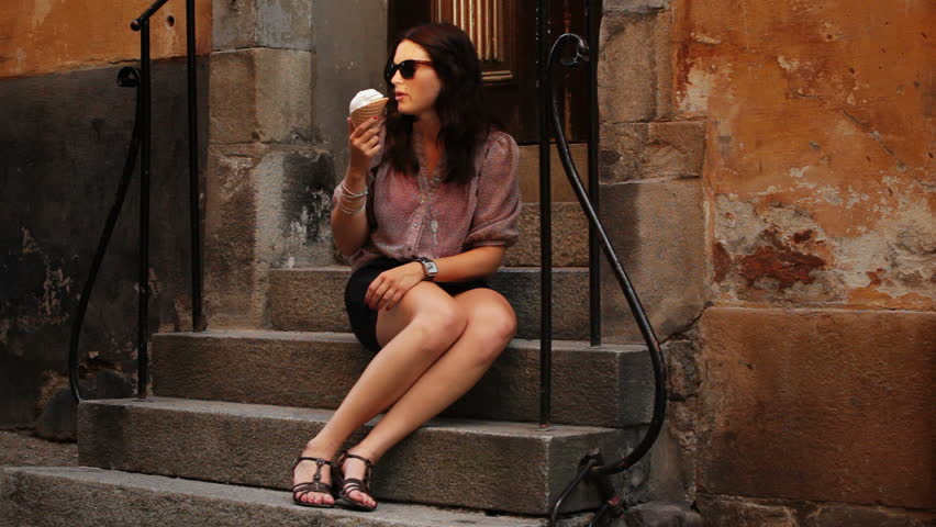 Young woman in old town eating ice cream | Shutterstock HD Video #1224097
