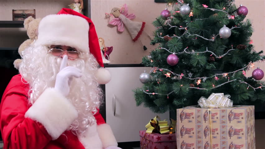 Santa Claus with a gift box chroma key. Santa put gift under the Christmas tree