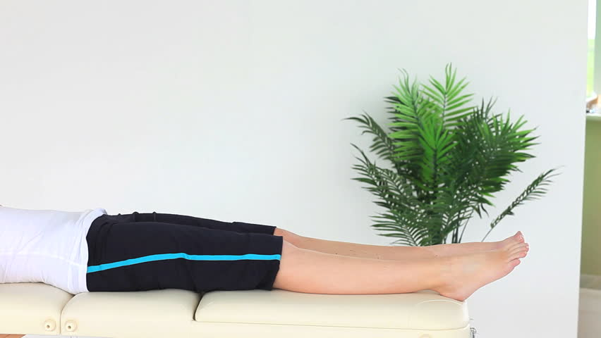Young woman doing some exercises helped by a physiotherapist | Shutterstock HD Video #1229074
