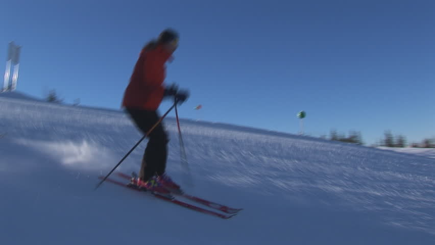 two skiers on flat slope - HD stock video clip