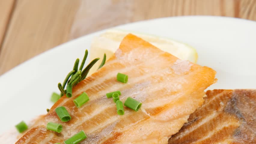healthy fish cuisine : grilled pink salmon steaks dish over wooden table 1920x1080 intro motion slow hidef hd