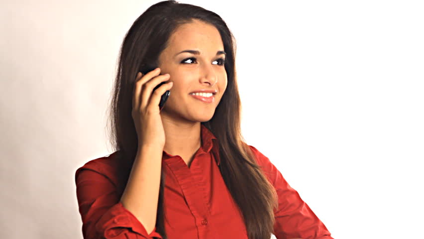 Young pretty business woman talking on smart phone - HD stock footage clip