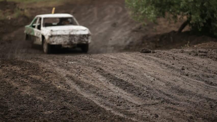 "SIMFEROPOL, UKRAINE - JULY 2:  Vintage cars participate in First Cup of Crimea ""Prohvat Derby"" (extreme auto derby), July 2, 2010, Simferopol, Crimea, Ukraine.   - HD stock video clip"