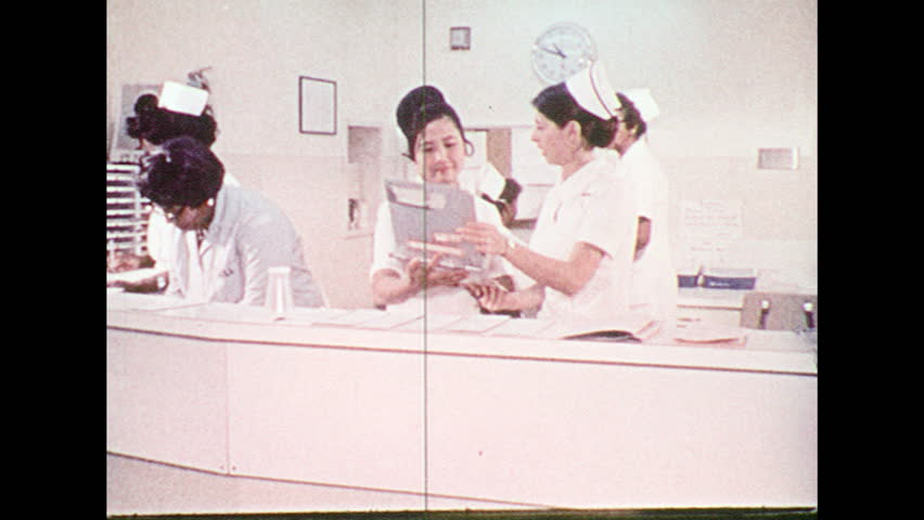 UNITED STATES 1970s – Nurses take care of patients. Doctor and nurse perform CPR on a patient.