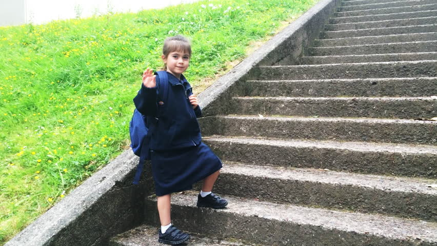 Child going to school (girl age 5-6) and say goodbye. People education concept