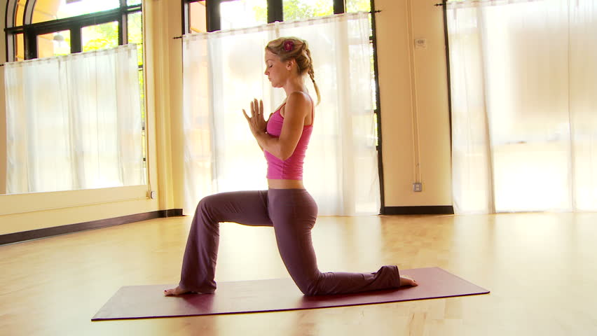 Young woman doing yoga - HD stock video clip