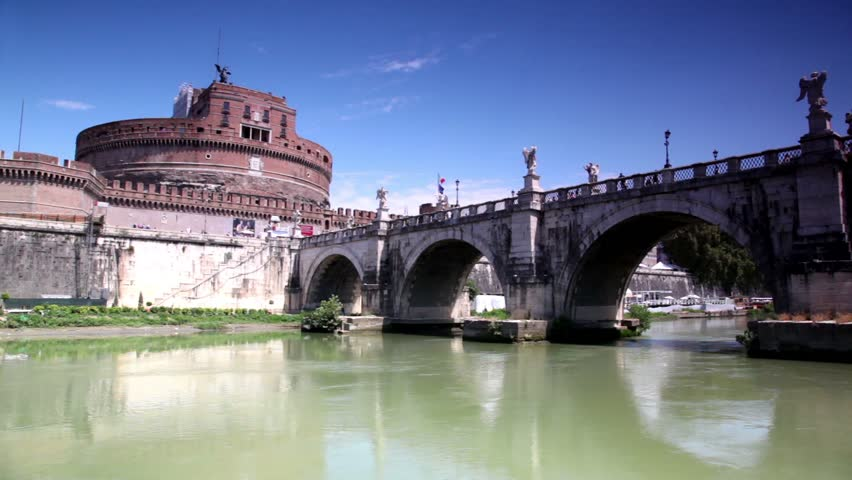 Sant Angelo Castel the view in motion from the river, camera goes under Sant Angelo Bridge and then shows other side - HD stock video clip