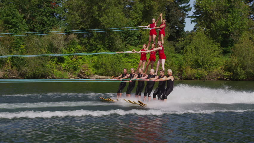 Cinemagraph - Stunt water skiers form human pyramid . Motion Photo.