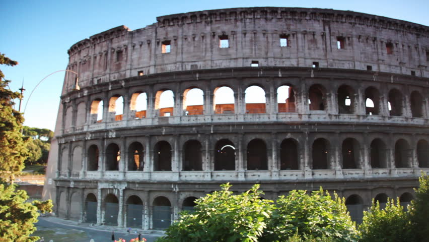 Colosseum or Flavian Amphitheatre in Rome, view from passing bus - HD stock video clip