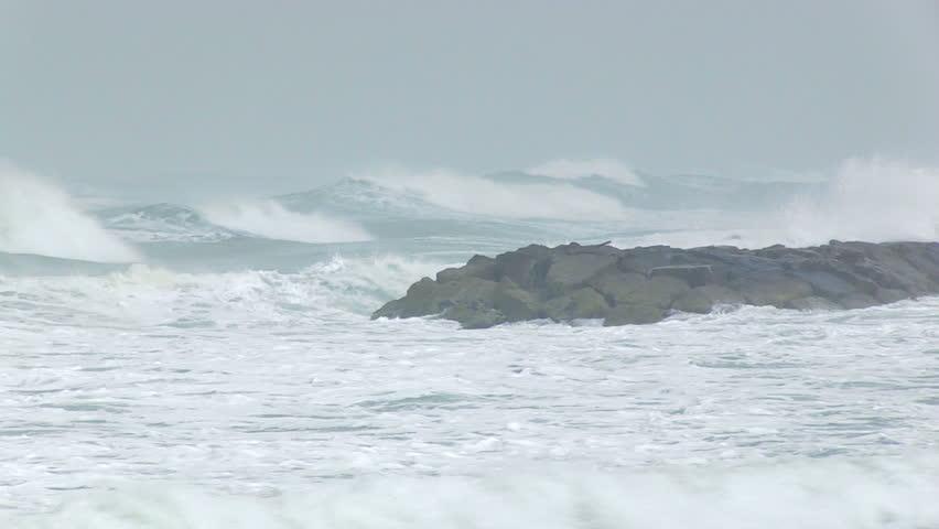 Extreme waves crushing the coastline ??? breaking on the rocks.