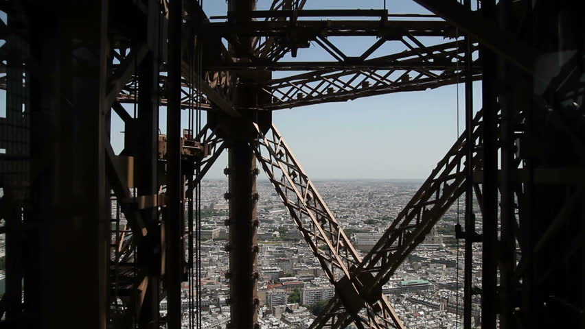 Eiffel Tower elevator. Fixed camera viewpoint going up from 2nd to 3rd floor. - HD stock footage clip