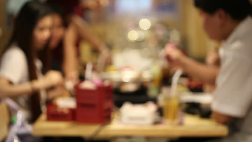 Dinner in a restaurant. Group of people eating and talking. shabu shabu  - HD stock footage clip
