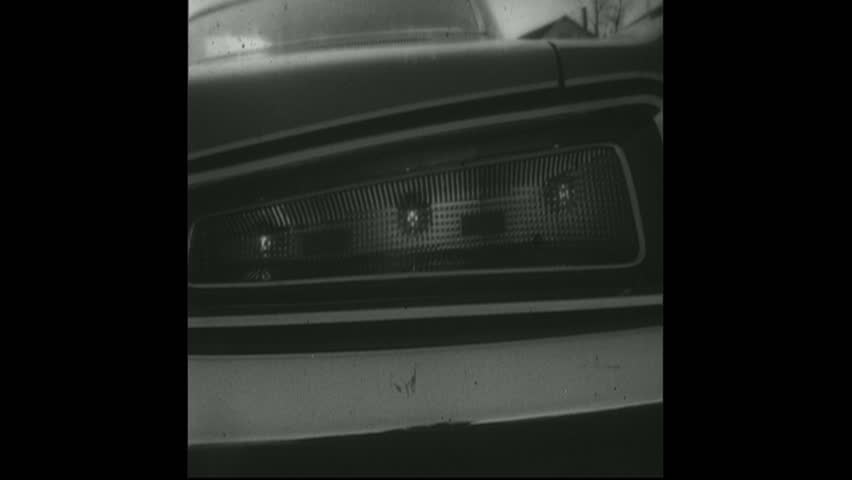 UNITED STATES 1960s - Blinking car tail light, hand honking car horn, traffic light, two cars bumping, railroad crossing sign. - HD stock video clip