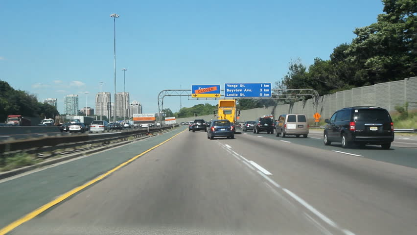 Summer highway. Driving on Highway 401 in the summer. Toronto, Ontario, Canada.  - HD stock video clip