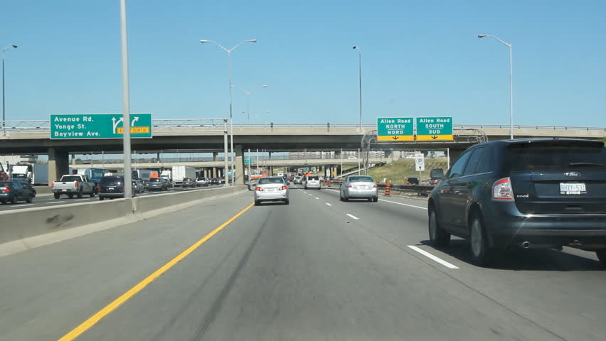 TORONTO, CANADA - JULY 14: Driving on Highway 401 in Toronto on July 14th, 2011. The segment of Highway 401 passing through Toronto is the busiest highway in North America. - HD stock footage clip