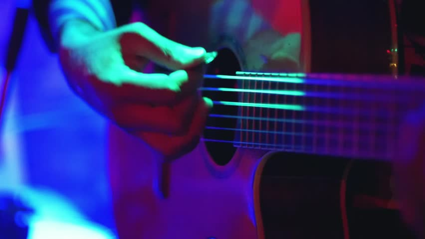 close up of a musician playing electric guitar at a night club stock footage video 7565287. Black Bedroom Furniture Sets. Home Design Ideas