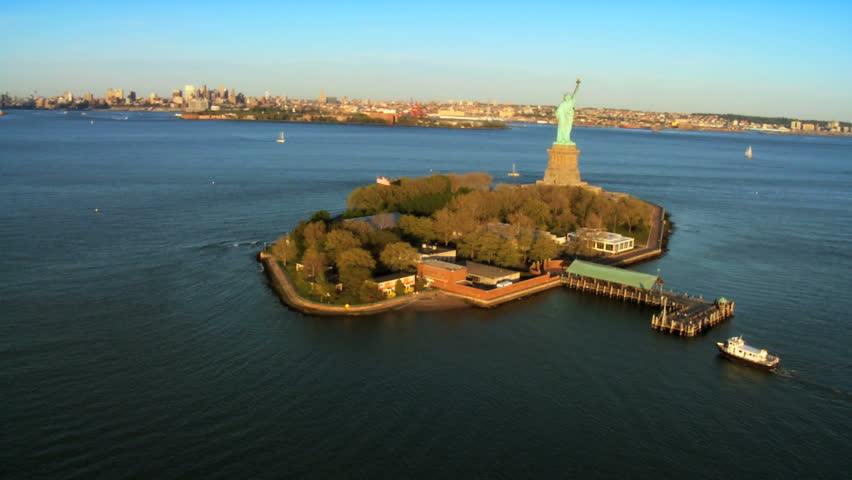 Aerial view of the Statue of Liberty, Ellis Island and Downtown Manhattan, New York, North America, USA - HD stock footage clip