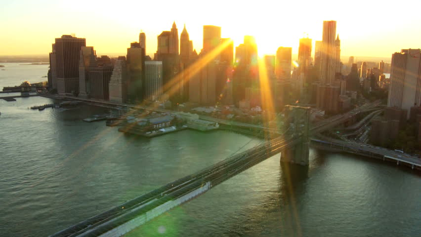 Aerial view of New York Financial District of Manhattan, Brooklyn Bridge and the Hudson River at Sunset, North America, USA | Shutterstock HD Video #1277386