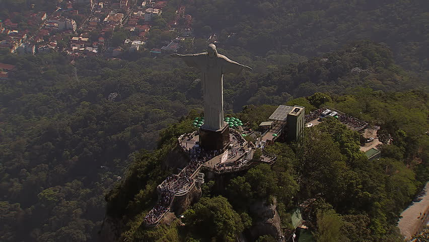 RIO DE JANEIRO, BRAZIL - OCTOBER 2015: Overhead Aerial  Shot of Christ the Redemeer Statue reveal  Rio de Janeiro, Brazil.Spectacular View of Christ overlooking Rio with people visiting Corcovado Hill