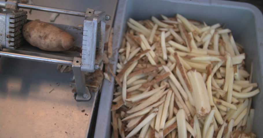 Fries cutting above wide shot - 4K stock footage clip