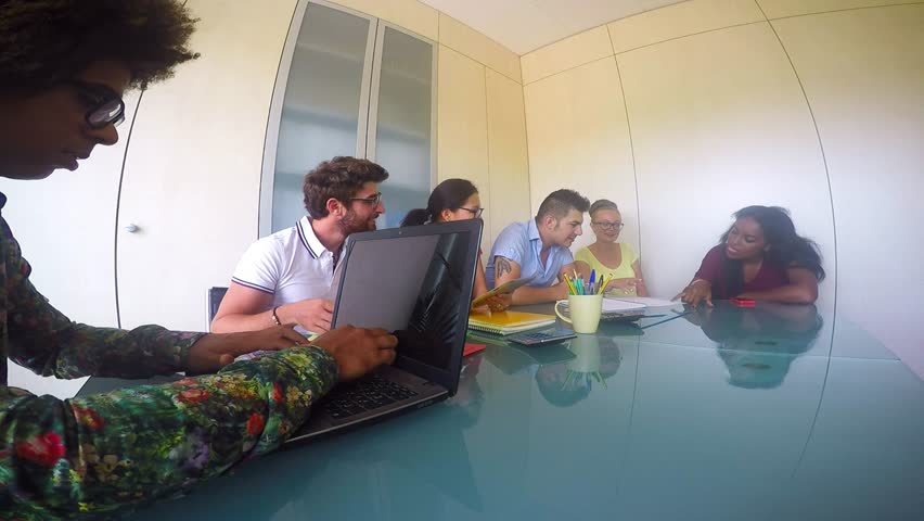 Group of young innovative people on a business meeting - Start up office,Multiracial group of businessmen planning a new market strategy
