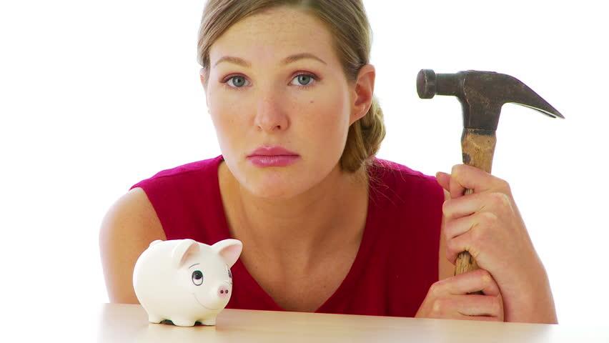 Woman preparing to break into her piggy bank - HD stock video clip