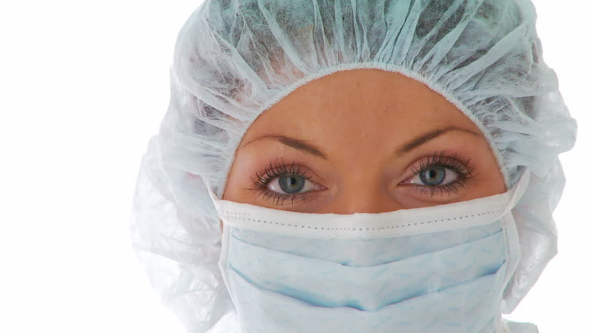 Close up of young woman wearing doctor mask and hair net - HD stock footage clip